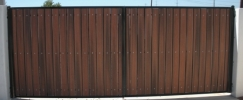 Classic RV gate with black steel and redwood composite