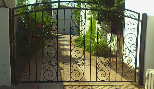 arched single swing gate with big S and small S scrolls