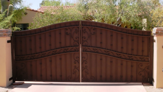Arched decorative driveway gate; secure, private & beautiful entry