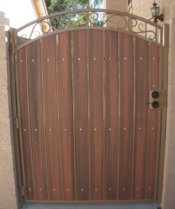 arched decorative gate with tan steel and redwood composite
