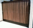 Single swing RV gate with plate steel kickplate