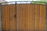 arched decorative with uneven gate split and stained wood
