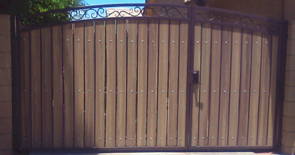decorative arched RV gate with uneven split of gates