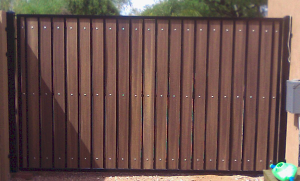 classic-style RV gate with black steel and dark composite