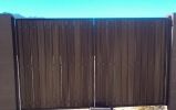 classic-style RV gate with dark brown steel and dark composite